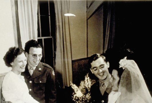 Bride Is Shown Handing First Piece of Wedding Cake, Newport News, Virginia, U.S. Army Signal Corps, Hampton Roads Port of Embarkation, April 7, 1945, Computer file: 1995, Library of Virginia, Richmond, Virginia.